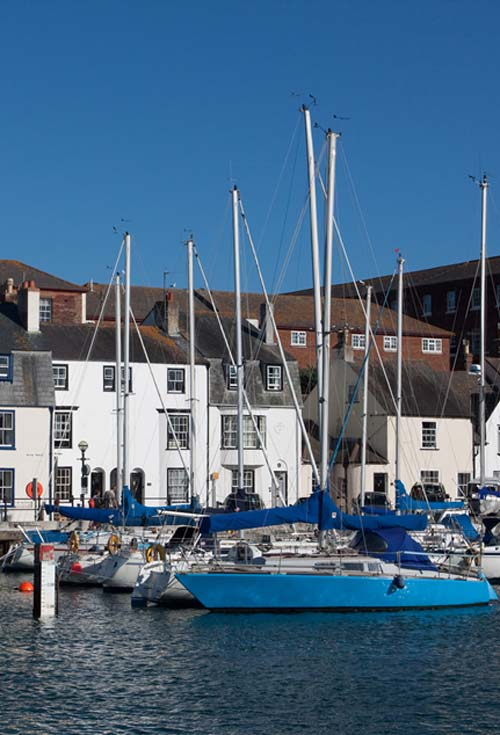 sailing boats in weymouth harbour